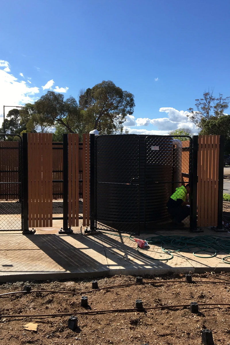 Enclosing water tank fencing solution Melbourne